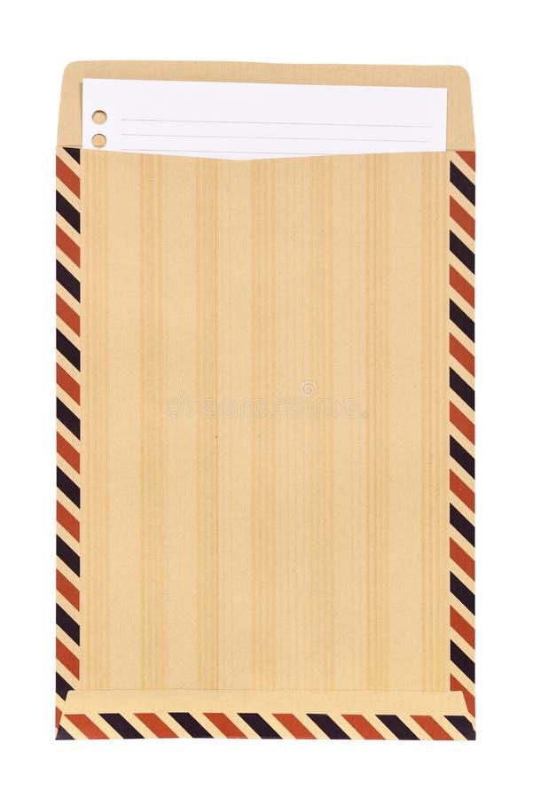 Brown-Umschlag mit weißem Briefpapier stockfotografie