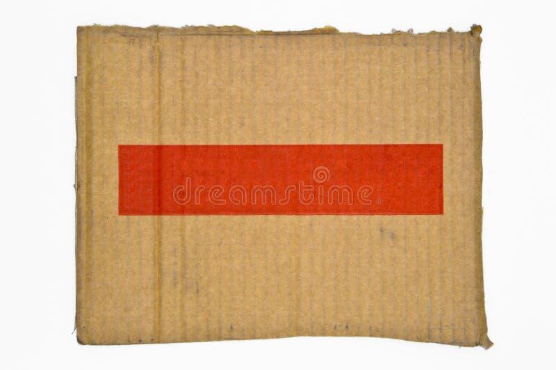 Brown und beige farbige Wellpappe Rote Fahne lizenzfreie stockbilder
