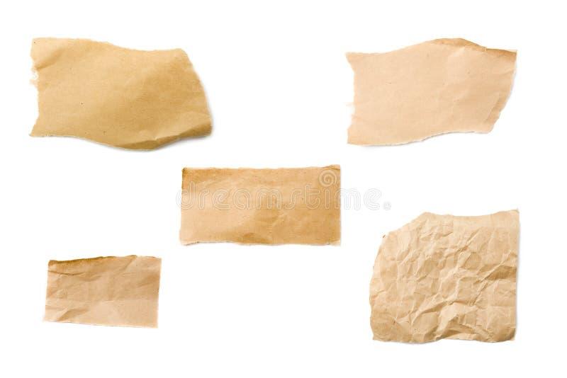 Brown-verpackende Papierstücke lizenzfreie stockfotografie