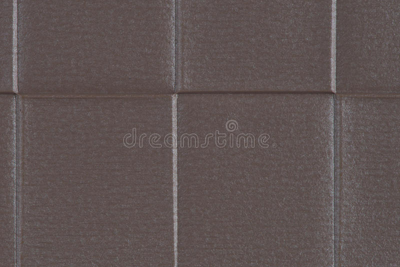 Brown vinyl texture. Embossed vinyl texture closeup texture background royalty free stock image