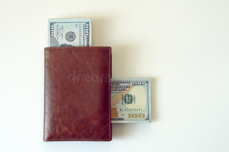 Brown wallet with money on white background stock images
