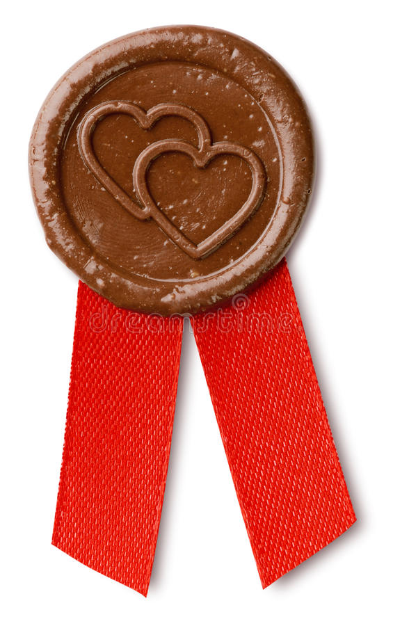 Brown wax seal with hearts stock photography