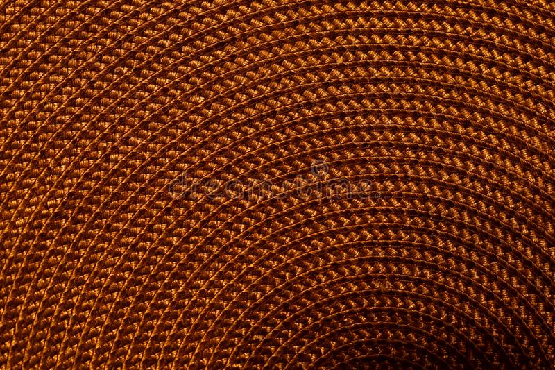Brown weaving. Background, texture. Cropped picture, close-up, place for text. Weaving in a circle. royalty free stock images