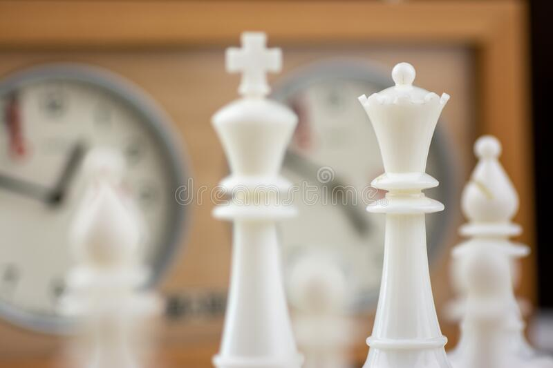 Brown and white chess board with chess pieces royalty free stock images