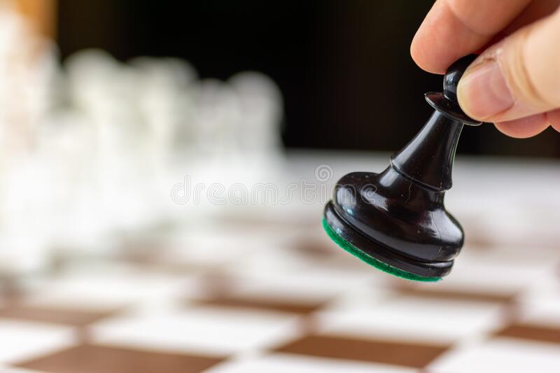 Brown and white chess board with chess pieces stock photo