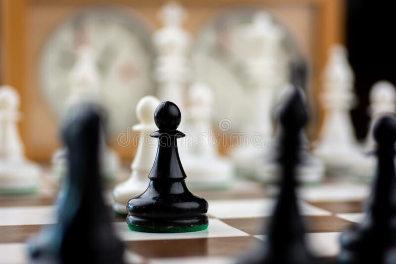 Brown and white chess board with chess pieces royalty free stock image