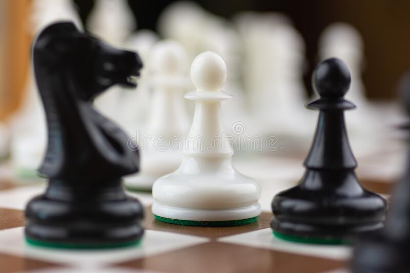 Brown and white chess board with chess pieces royalty free stock photography