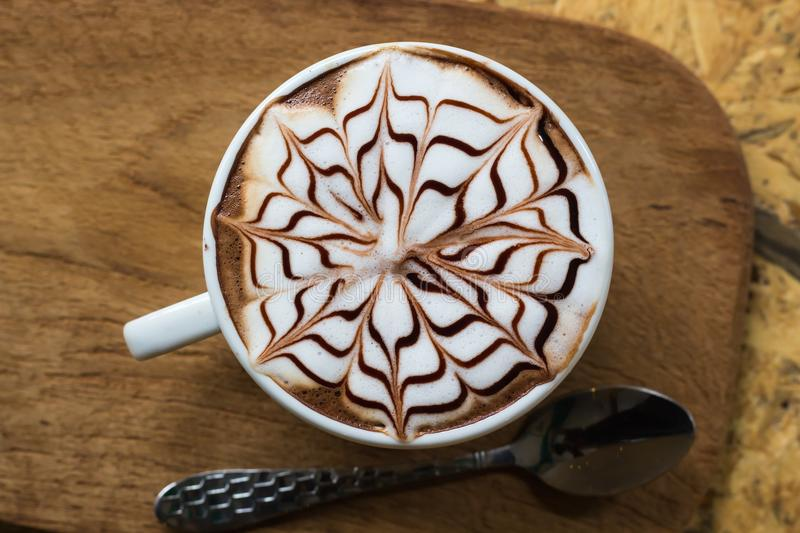 Brown and White Coffee With Floral Art in White Ceramic Mug stock photos