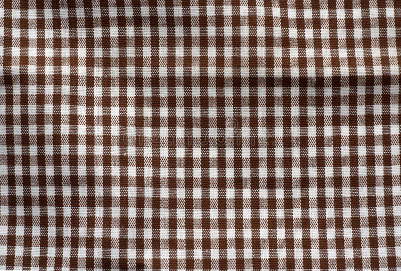 Brown and white color checked fabric texture stock images