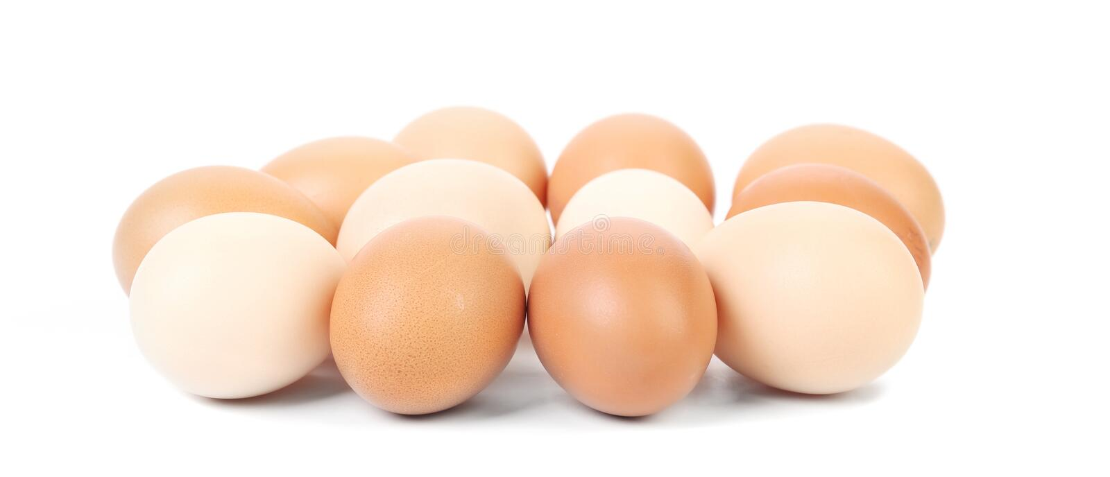 Brown and white eggs. On a white background stock photos