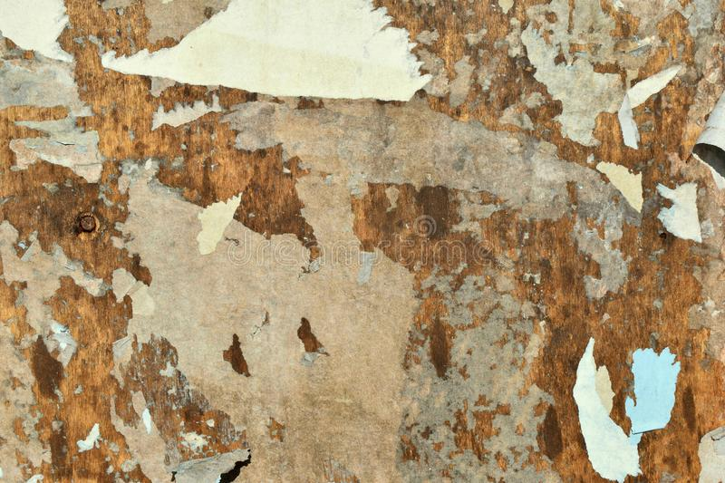 Brown, white and gray. The shreds of old posters on a billboard. Red and white. The shreds of old posters on a billboard.Old advertising.Abstraction paper color stock photo
