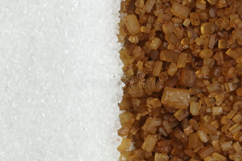 Brown and white sugar separation macro close up. Vertically aligned stock photography