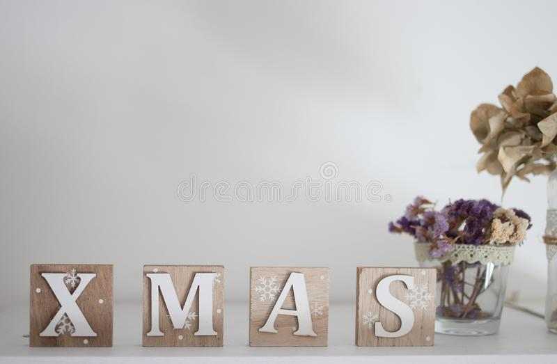 Brown and White Wooden Xmas Letter Table Decor stock images