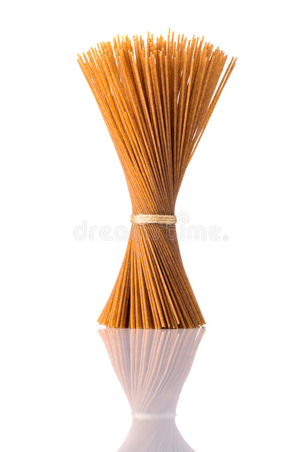 Brown Whole-Wheat Spaghetti Pasta on Isolated White Background royalty free stock photo