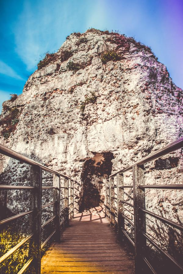 Brown Wodoen Boardwalk in Front of Gray Rocky Mountain Under Blue Sky stock photos