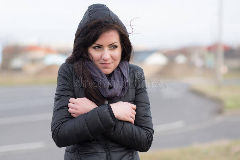 Brown woman feeling cold on the street. Brown hair woman feeling cold on the street royalty free stock images