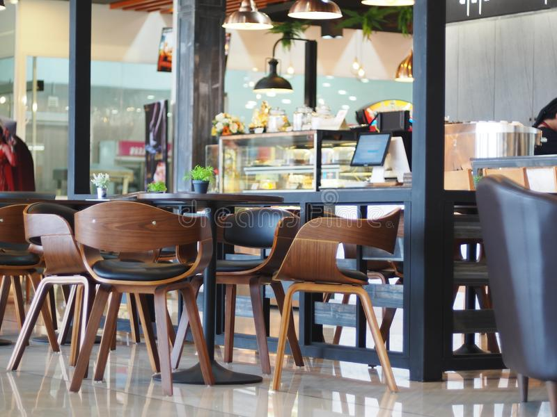 Brown wood curved chair sets crop closeup in a cafeteria coffee shop stock photography