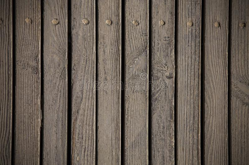 Brown wood desk board boardwalk texture. Abstract background, text space, empty template royalty free stock photo