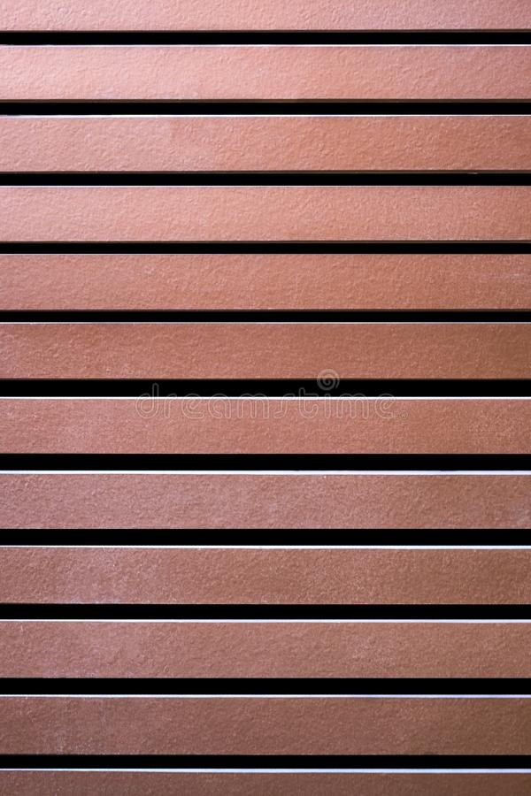 Brown wood duct panel or roof batten stock image