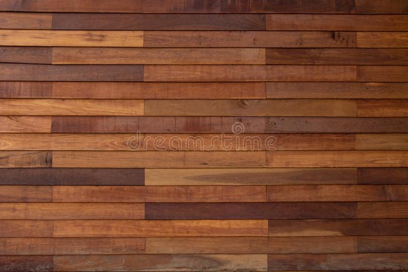 Brown wood grain background and various colors alternately look dimensional. Black background and other colors. There is space for. General use. Giving a royalty free stock photos