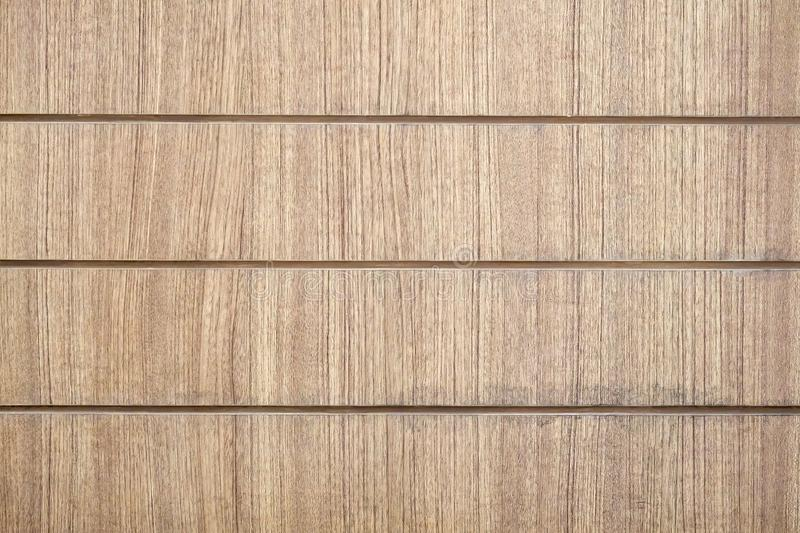 Brown wood grooved surface background texture. Modern style royalty free stock images