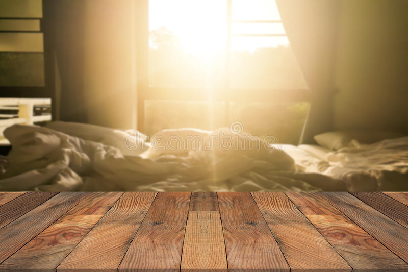 Brown wood table and blurry bed room in background. Empty table for display product royalty free stock photo