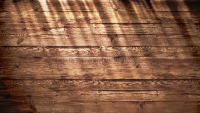Brown wood texture with bright sunlight, old wall background. top view of wooden table. texture of old top table, grunge stock image