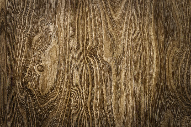 Brown wood texture with natural patterns. The brown wood texture with natural patterns stock image