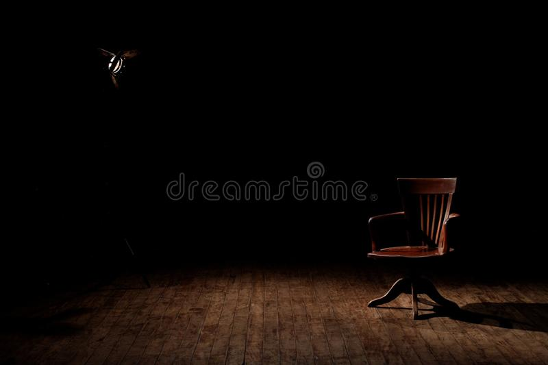 Brown Wooden Armchair on Brown Wooden Floor royalty free stock image