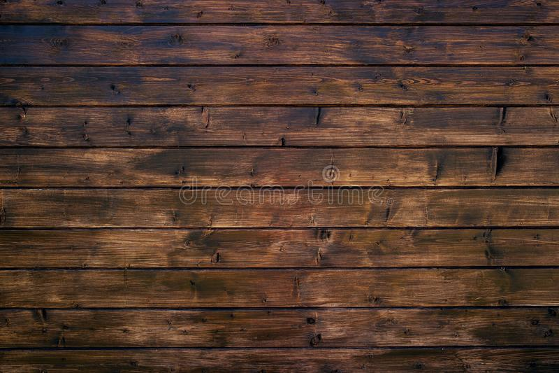 Brown wooden background. Facing wall boards. Brown wooden background. countertop Facing wall boards royalty free stock photography