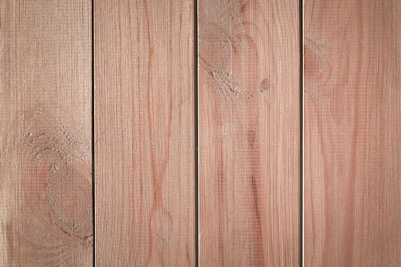 Brown wooden background with vertical boards. Natural wood texture.  royalty free stock photos