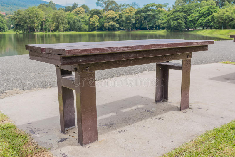 Brown Wooden Bench At A Green Lake Stock Photo