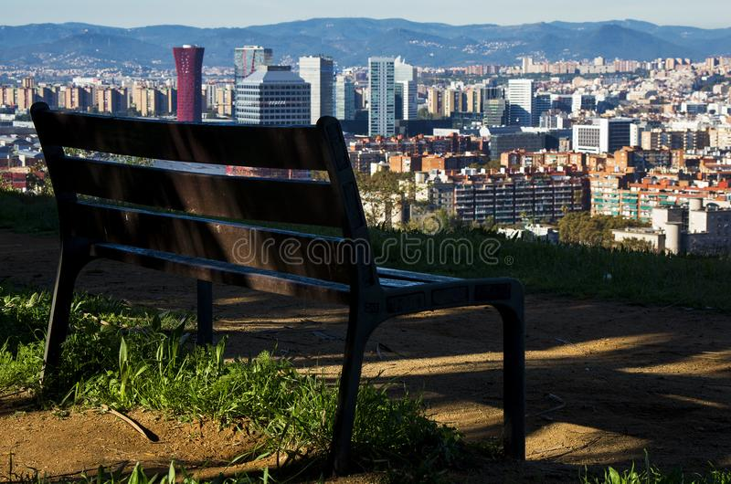 Brown Wooden Bench With Metal Frame Surrounded by Building Scenery royalty free stock photos