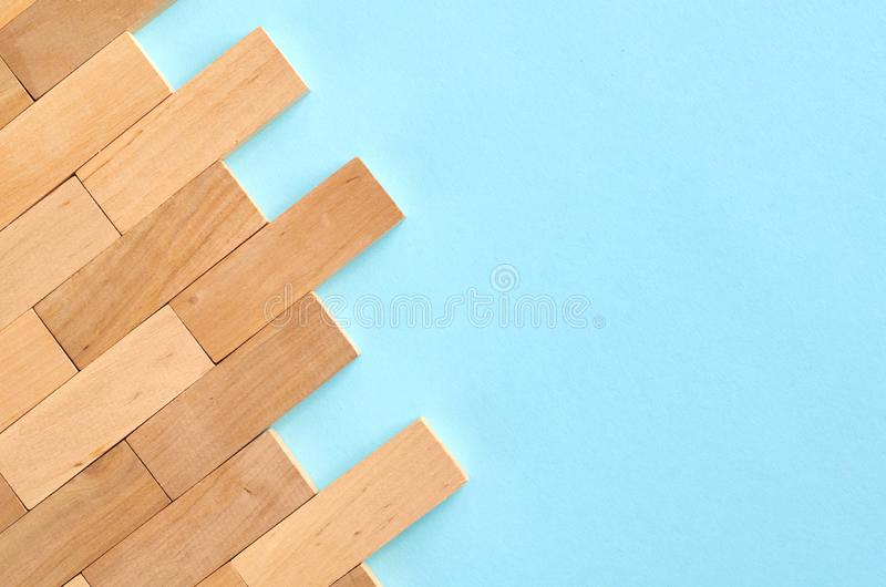 Brown wooden blocks idea on blue background composition. Flat lay and top view photo, border, wall, bricks, layout, above, bright, card, concept, copy, space stock image
