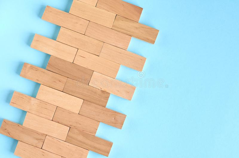 Brown wooden blocks idea on blue background composition. Flat lay and top view photo, border, wall, bricks, layout, above, bright, card, concept, copy, space royalty free stock images