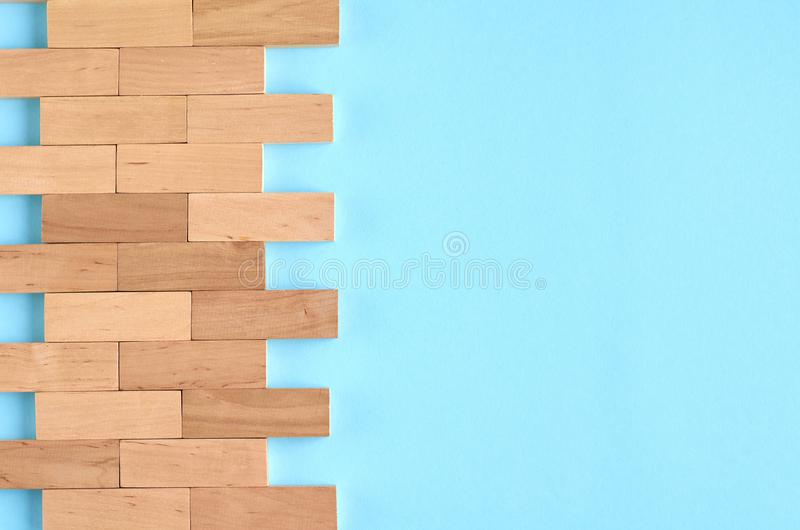 Brown wooden blocks idea on blue background composition. Flat lay and top view photo, border, wall, bricks, layout, above, bright, card, concept, copy, space stock photo