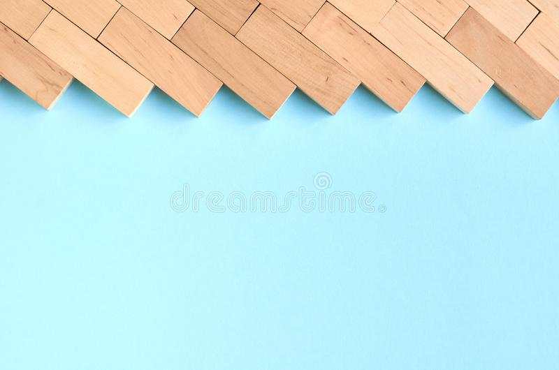 Brown wooden blocks idea on blue background composition. Flat lay and top view photo, border, wall, bricks, layout, above, bright, card, concept, copy, space stock images