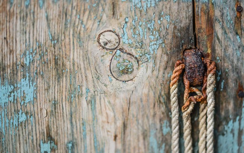 Brown Wooden Board With Rope royalty free stock image