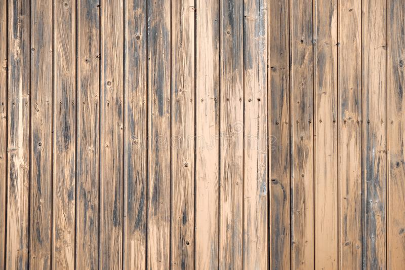Brown wooden boards of oak color. Vintage old fence or wall of house. Fittings of screws. Background abstract pattern. stock photography
