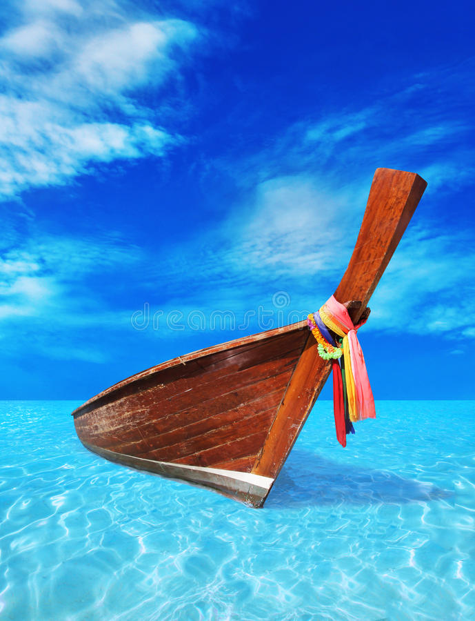 Free Brown Wooden Boat In The Blue Sea Royalty Free Stock Image - 52083286