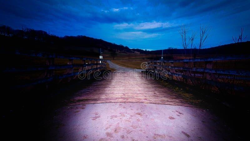 Brown Wooden Bridge Under Blue Cloudy Skies stock photos