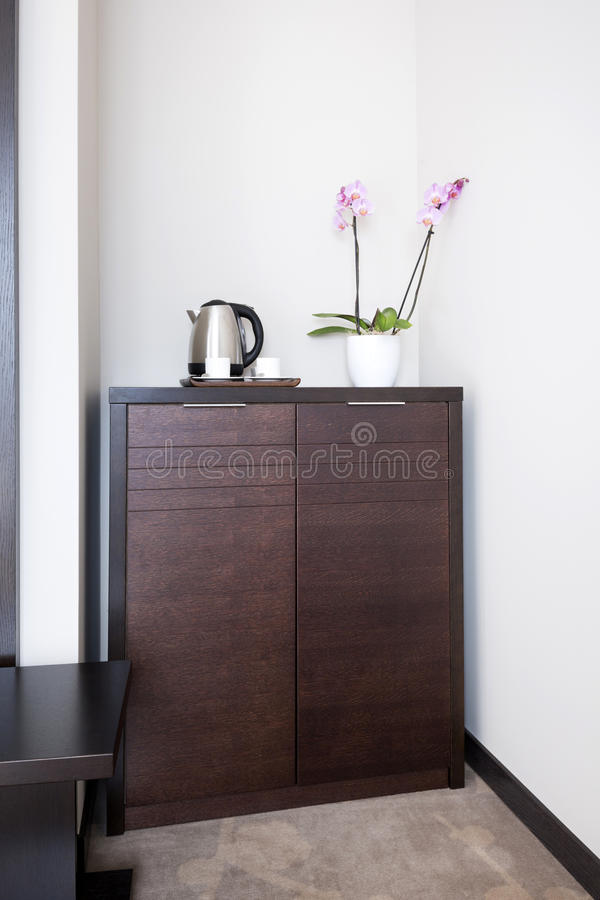 Brown wooden cabinet in hotel room.  royalty free stock image