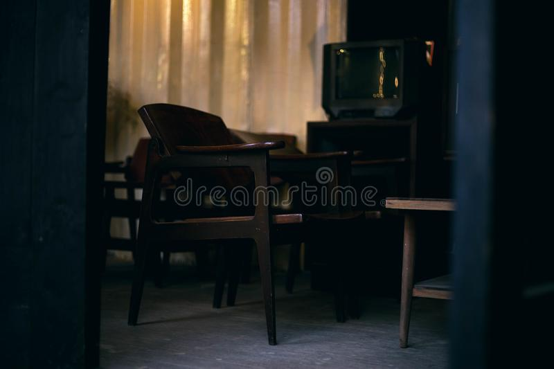 Brown Wooden Chair and Gray Crt Tv stock photo