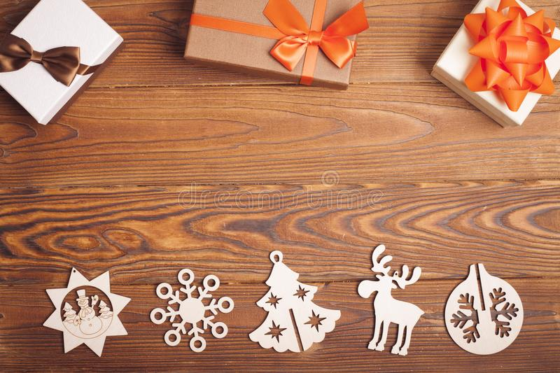 Brown wooden Christmas background with gifts and toys stock images