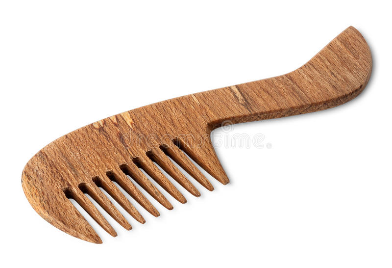 Brown wooden comb for hair. Isolated on white background royalty free stock photography