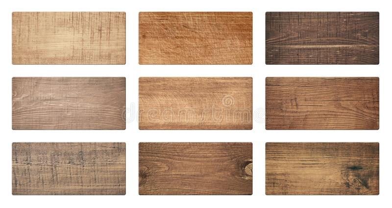 Brown wooden cutting boards, signboard, planks are isolated on white background royalty free stock photos