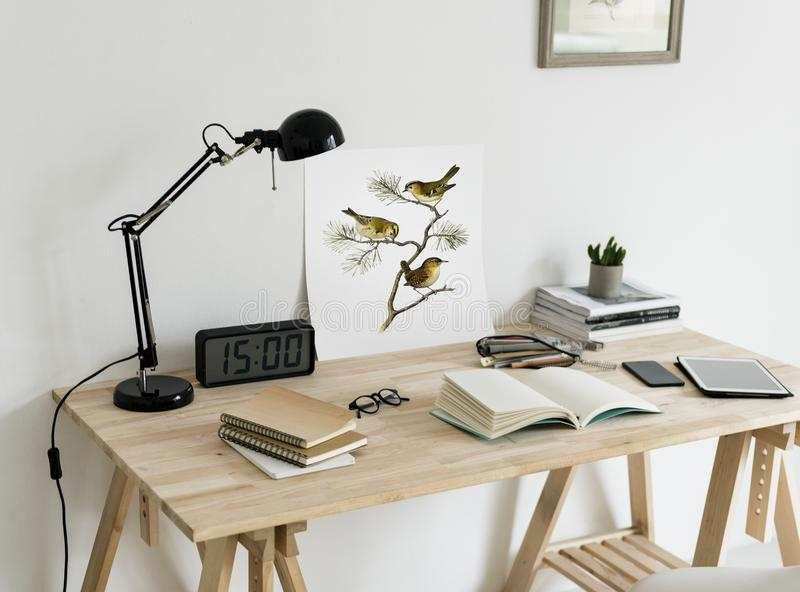 Brown Wooden Desk With Table Lamp royalty free stock photos
