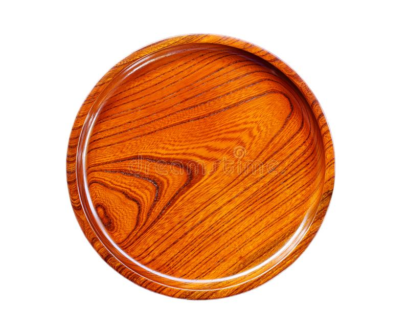Brown wooden dish isolated on white background. Blank of brown wooden dish isolated on a white background royalty free stock photo