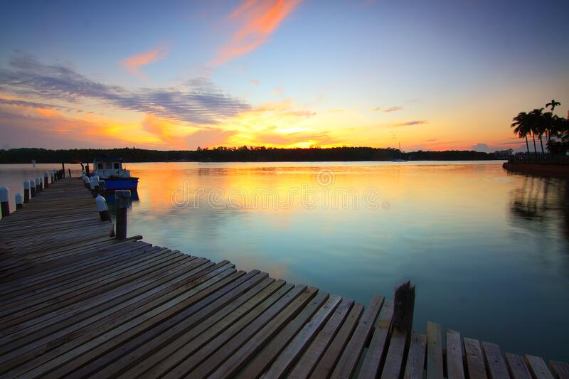 Brown Wooden Dock On Body Of Water During Twilight Free Public Domain Cc0 Image