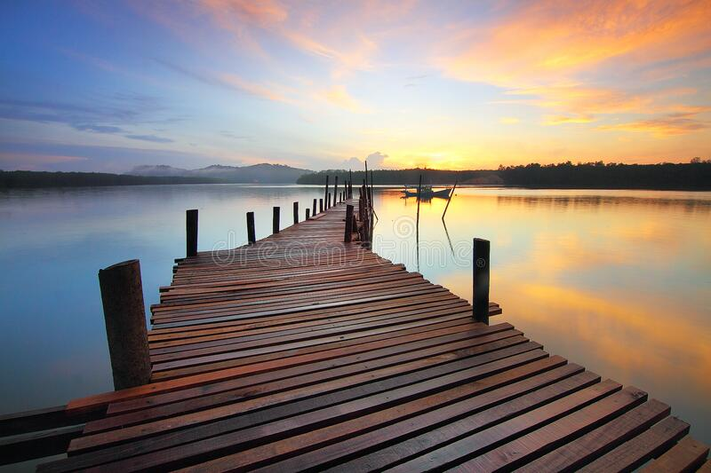 Brown Wooden Dock On Calm Body Of Water Surrounded By Silhouette Of Trees During Sunset Free Public Domain Cc0 Image